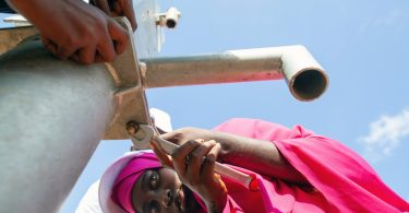 """On 4th November 2019, 18-year-old Muslima Abdi Nur, learns how to install a water pump at the UNICEF-supported Youth Empowerment Centre in Dollow, Somalia. The Centre provides training for young displaced Somali men and women in construction, engineering and plumbing. 500 IDPs have participated in the programme since it began with the aim of encouraging youth to learn and develop skills in order to secure employment. As part of a pilot initiative, the Centre also aims to empower young women with non-traditional skills and employment opportunities.Muslima has been on the course for two months having fled her hometown three years ago due to fighting and famine. Once she completes the course, she wants to install water pumps across the Kabasa IDP camp where she currently lives: """"I love this course. I've learnt so much! My friends cannot believe that I'm able to do this - especially as a woman. But now it is time to give something back. I want to install water pumps across the camp where I live so it is a better place where everyone can have access to water""""."""